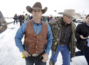Armed Ryan Bundy standing with now-deceased LaVoy Finicum in Oregon (Photo via AP)