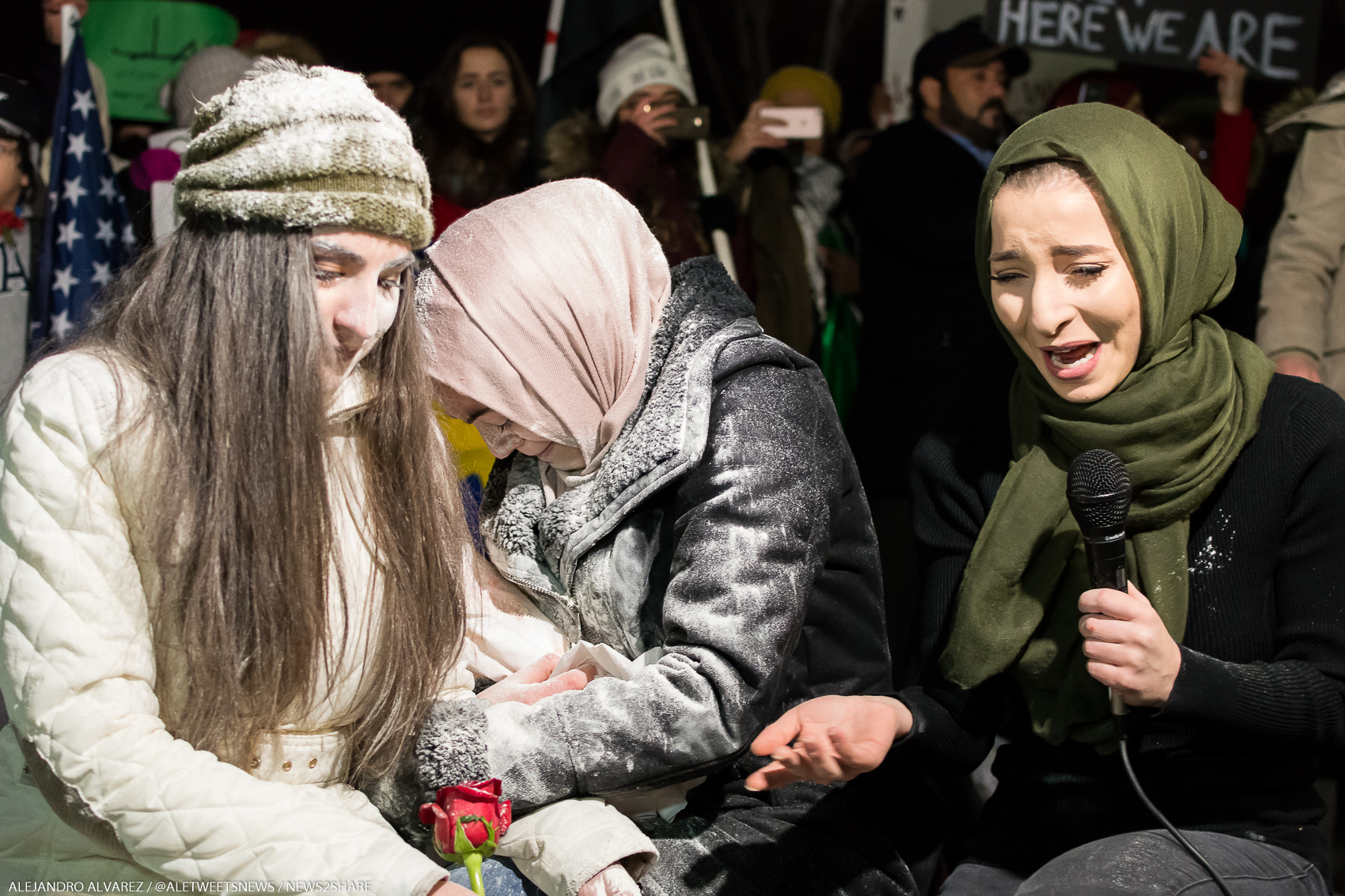 Meriem Abou-Ghazaleh recreates what life is like for Aleppo civilians during a vigil outside the White House on Dec. 16.